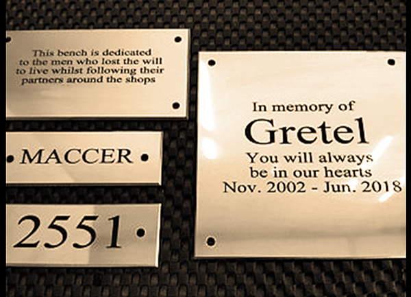 Bronze memorial plaques laid on black background